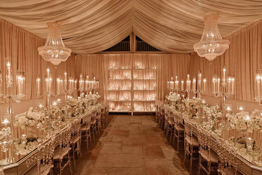 Dining room interiors, chandeliers, and candelabras at a winter wonderland wedding | Photographer: Kristyn Hogan