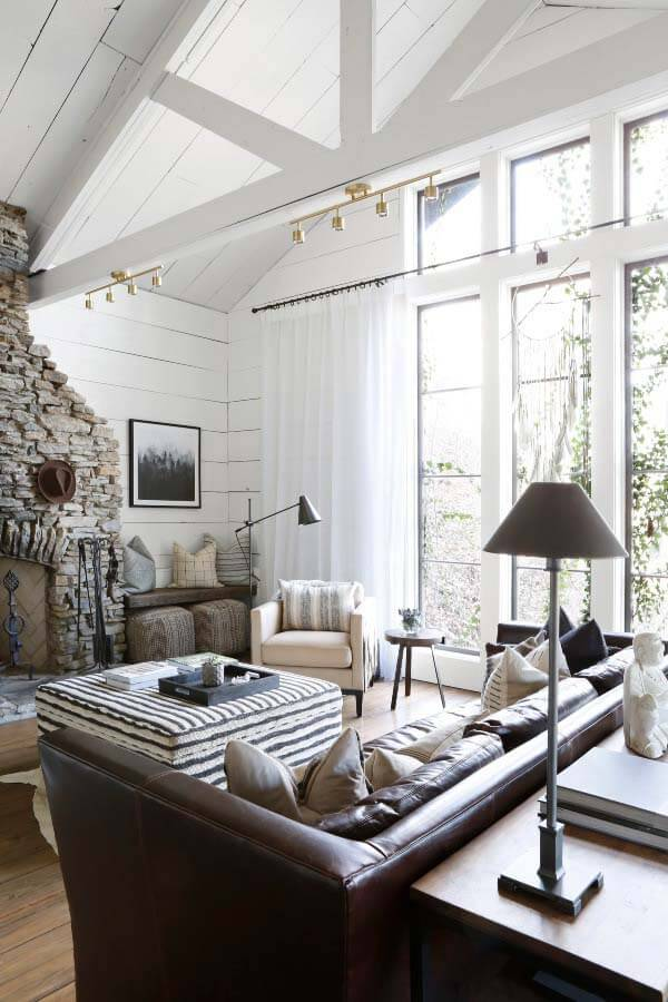 April Tomlin-designed living room with stone fireplace
