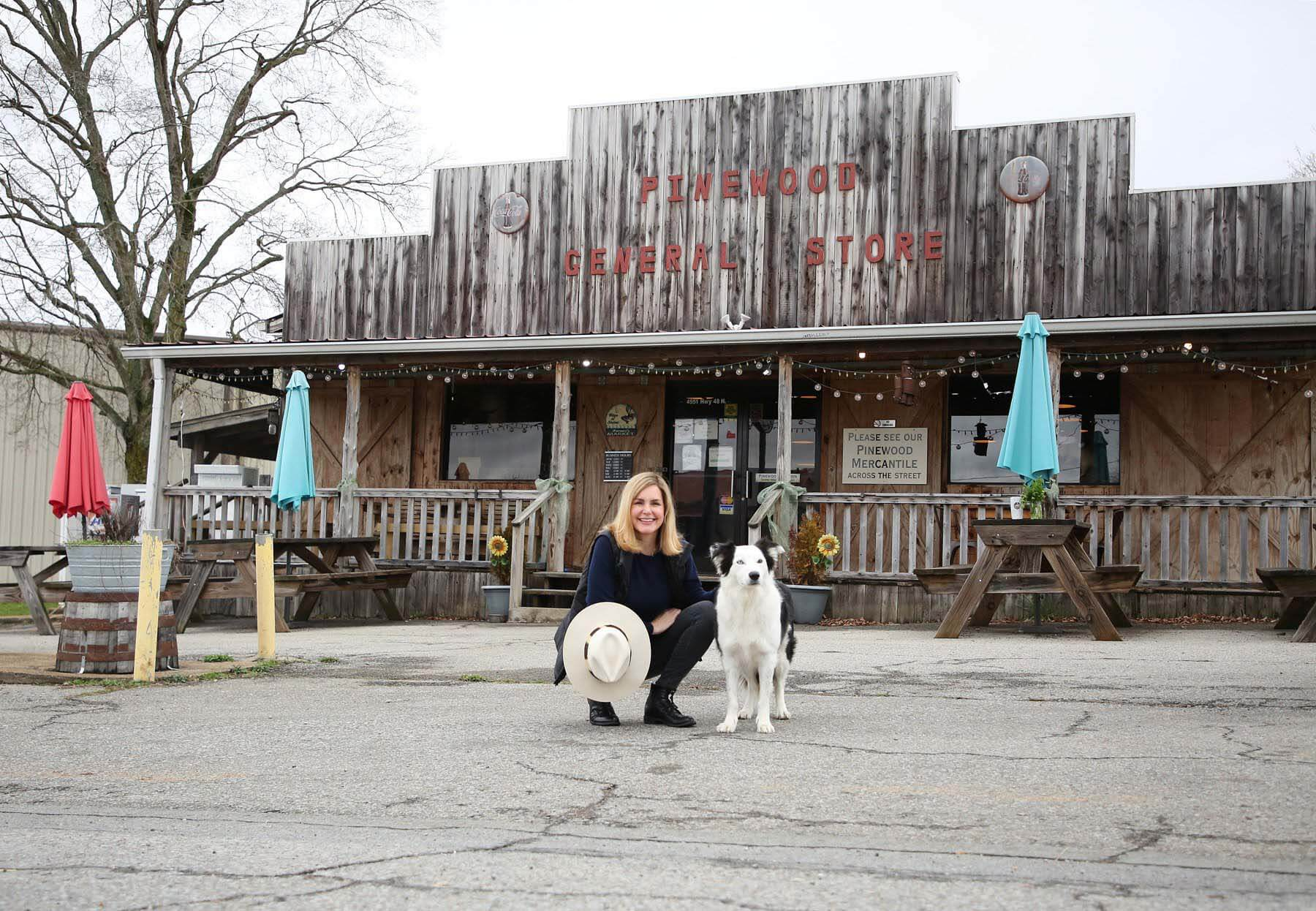 Mee and her dog in front of the Pinewood Kitchen restaurant