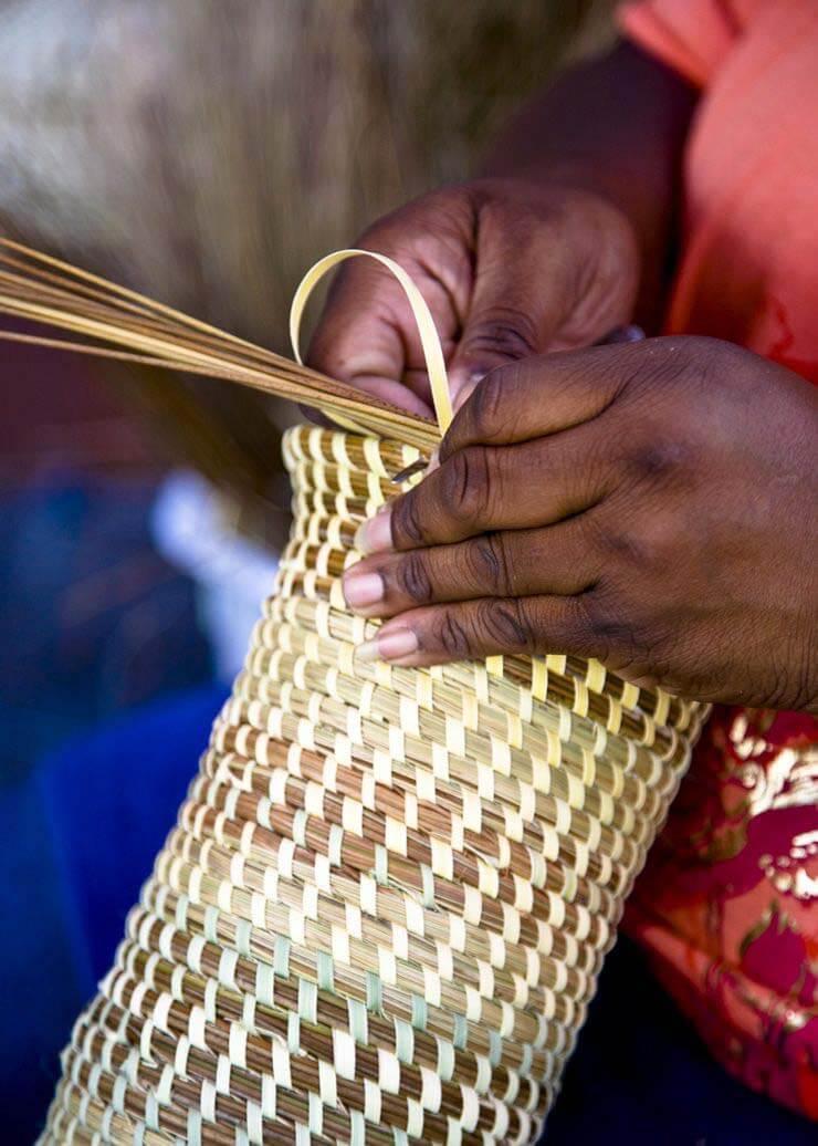 Woman making sweetgrass baskets