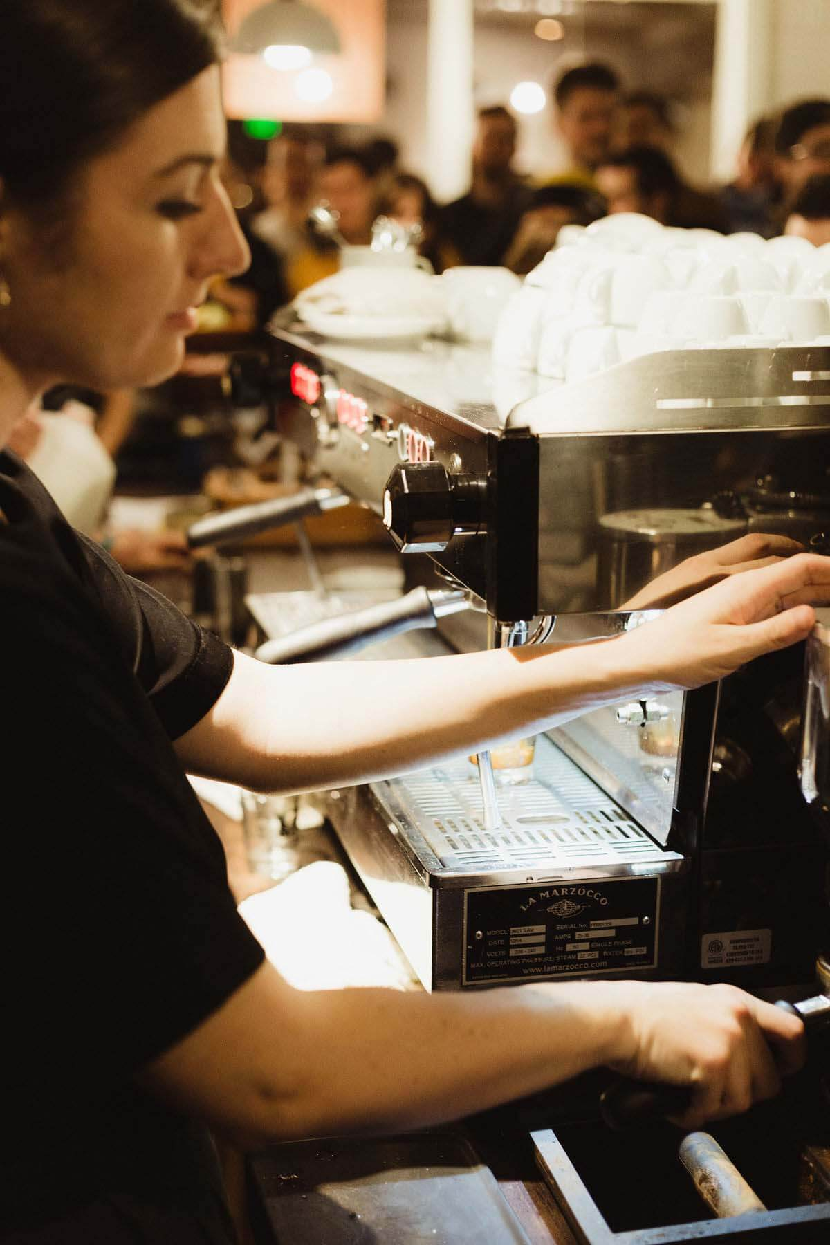 Offering barista secrets as she goes, Victoria Quirk makes coffee at Crema