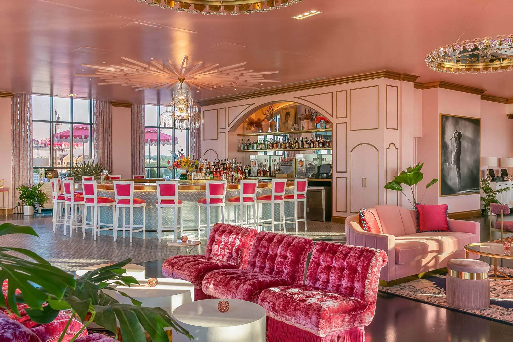 Interior of White Limozeen, with pink decor and a huge bar setup