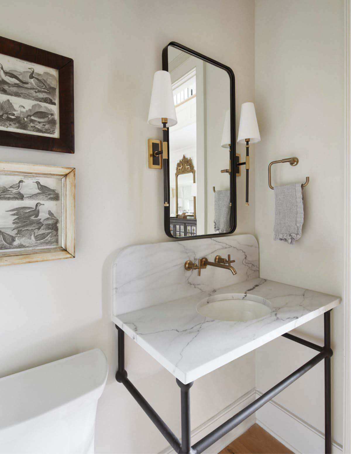 White powder room with marble countertop