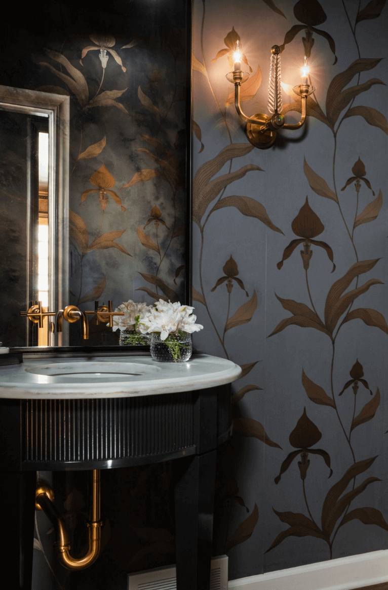 Dark-colored powder room with patterned wallpaper