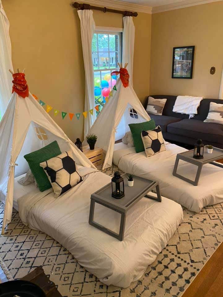 Two teepees set up and decorated for a young boy's birthday