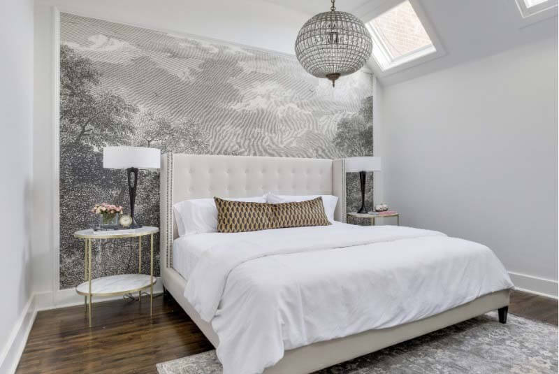 Black and white mural behind bed in statement wall design by Brad Ramsey