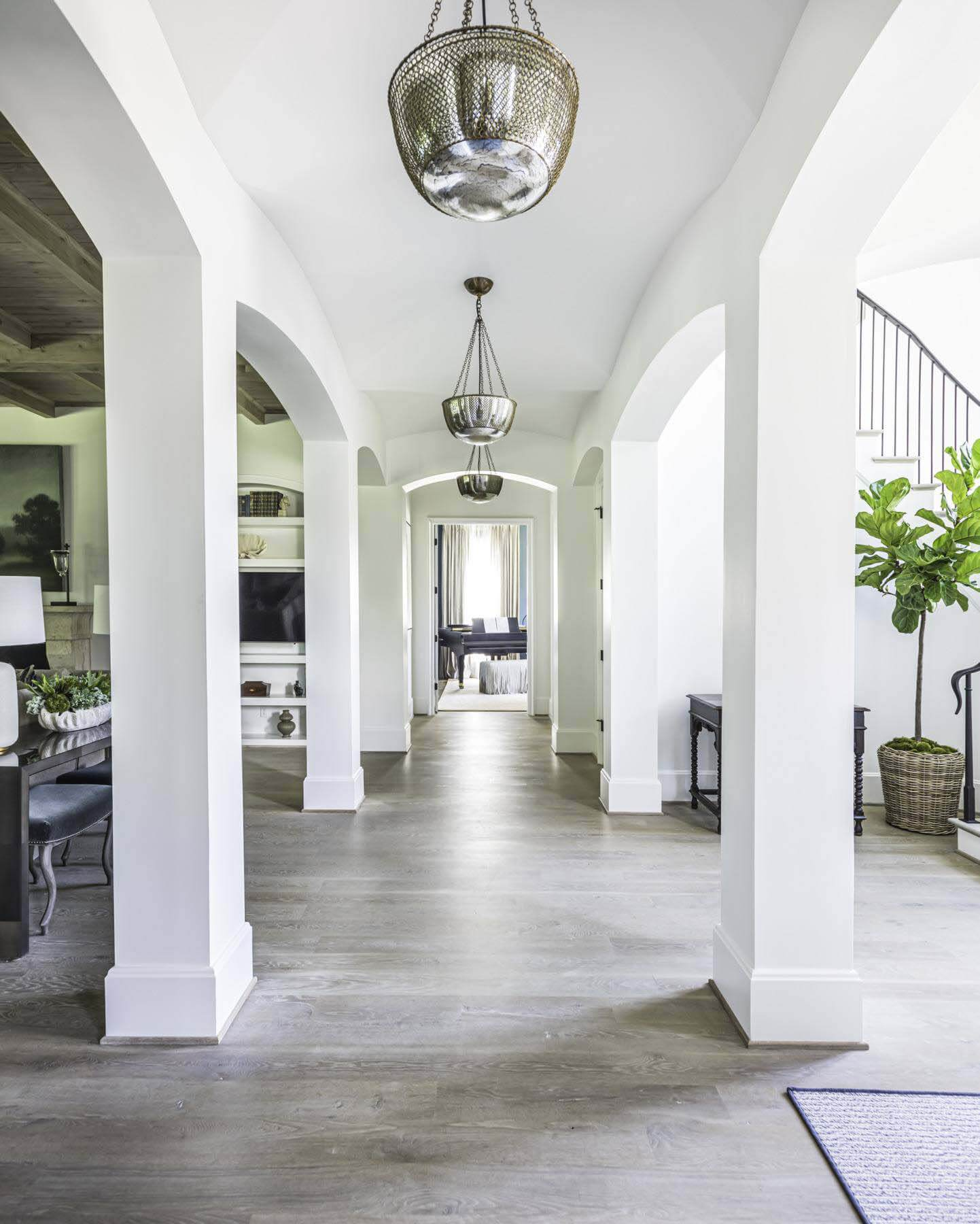 open floor plan by Castle Homes, with hallway and stairwell