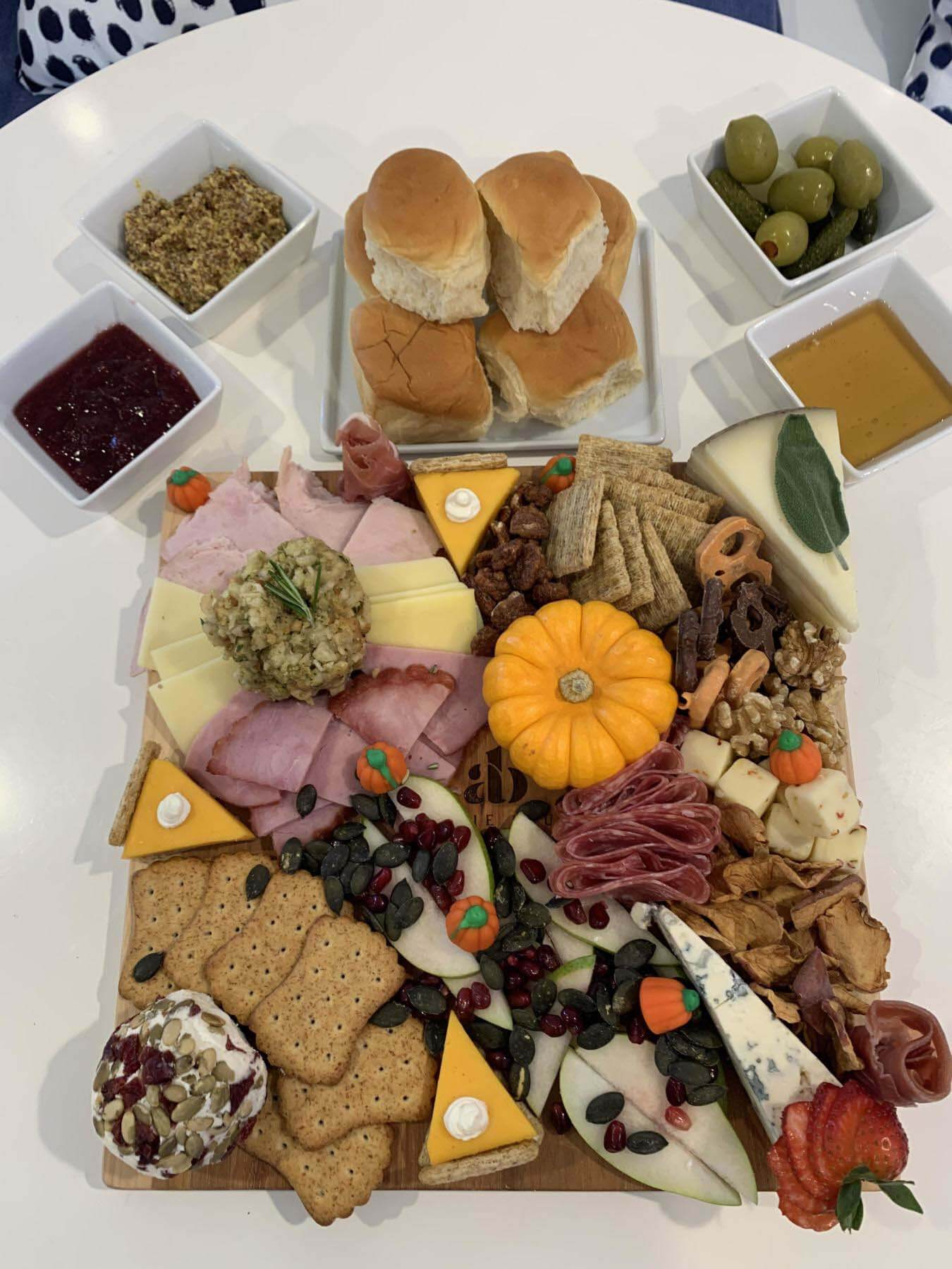 Anzie Blue's Thanksgiving takeout cheese and charcuterie tray with condiments.
