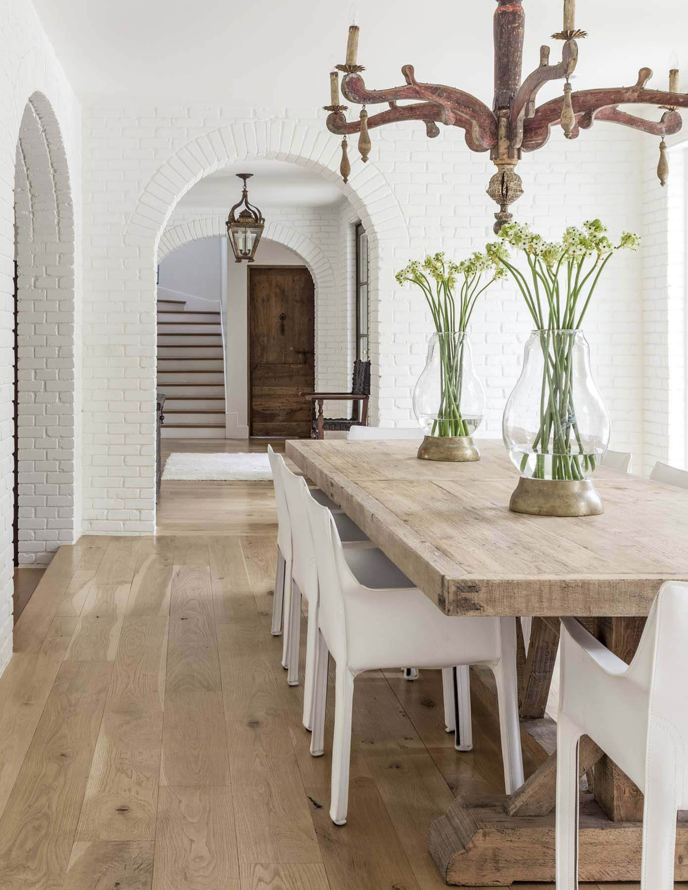 Dining room with natural wood table and white chairs