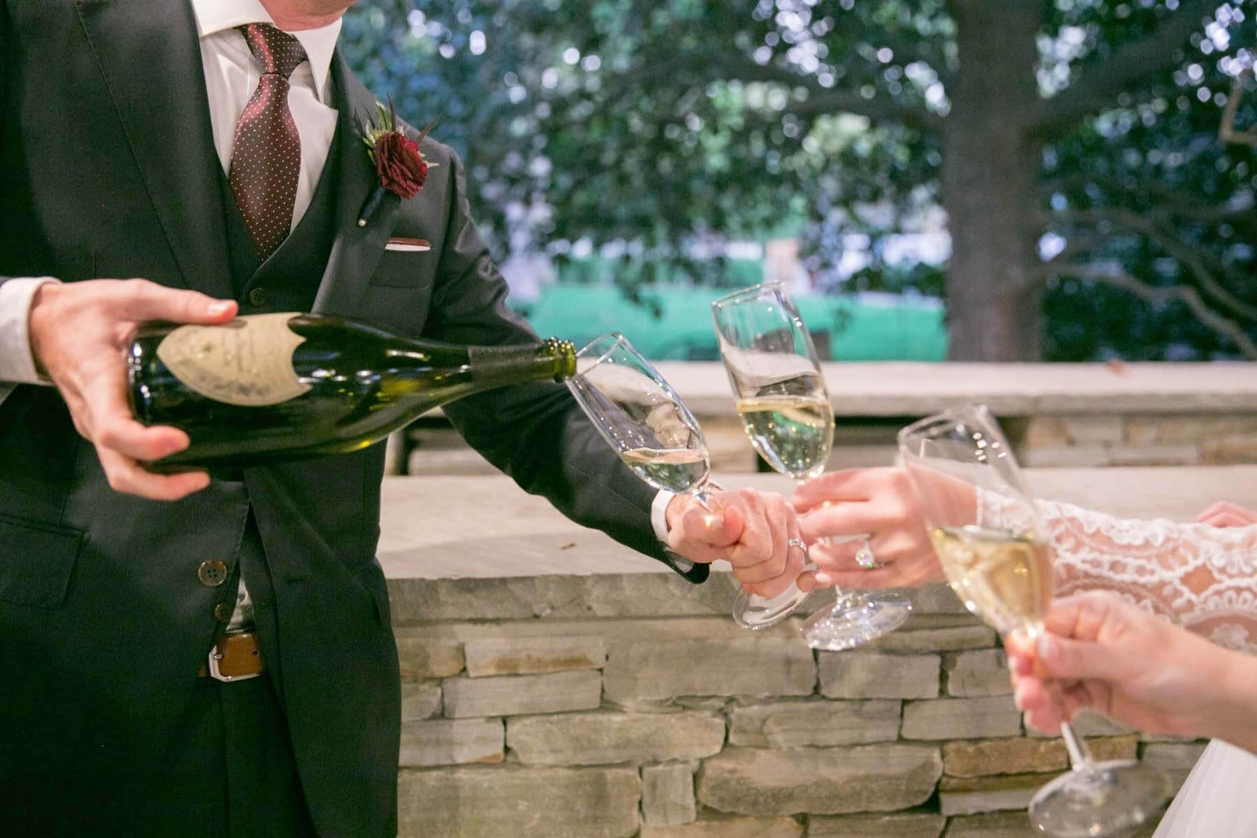 Champagne being poured for the bridal party