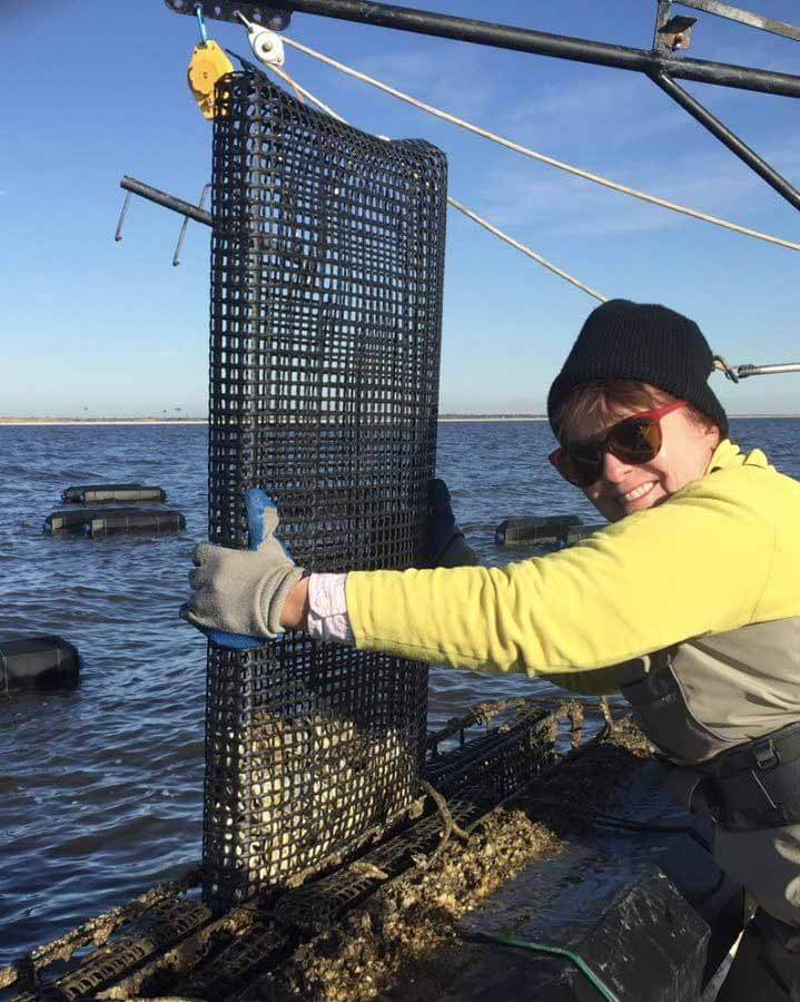 Anita pull up oysters from the Mississippi Sound