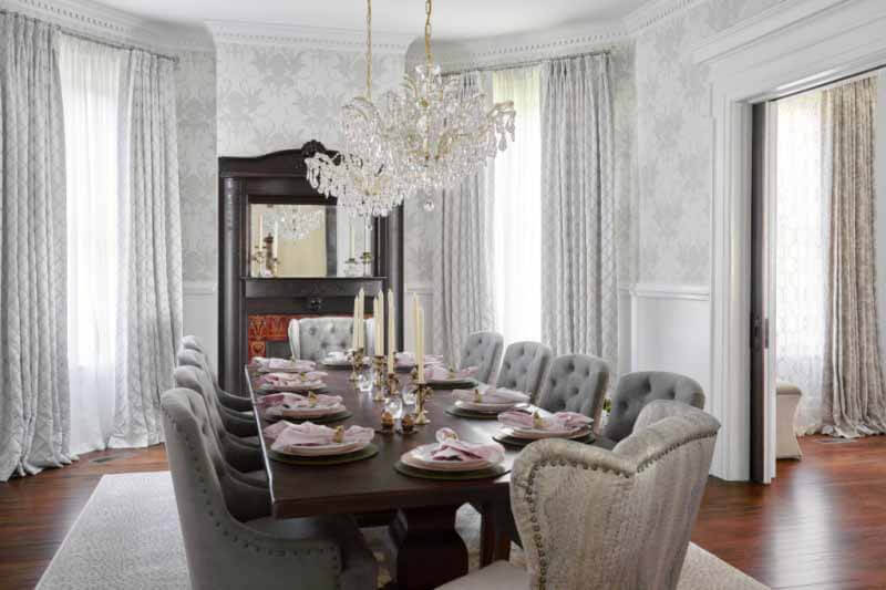 Original fireplace mantel overlooking dining table and chairs