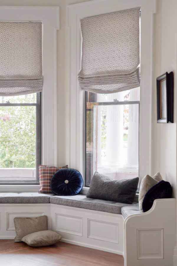 Bay window and built-in bench in the great room of a renovated victorian home