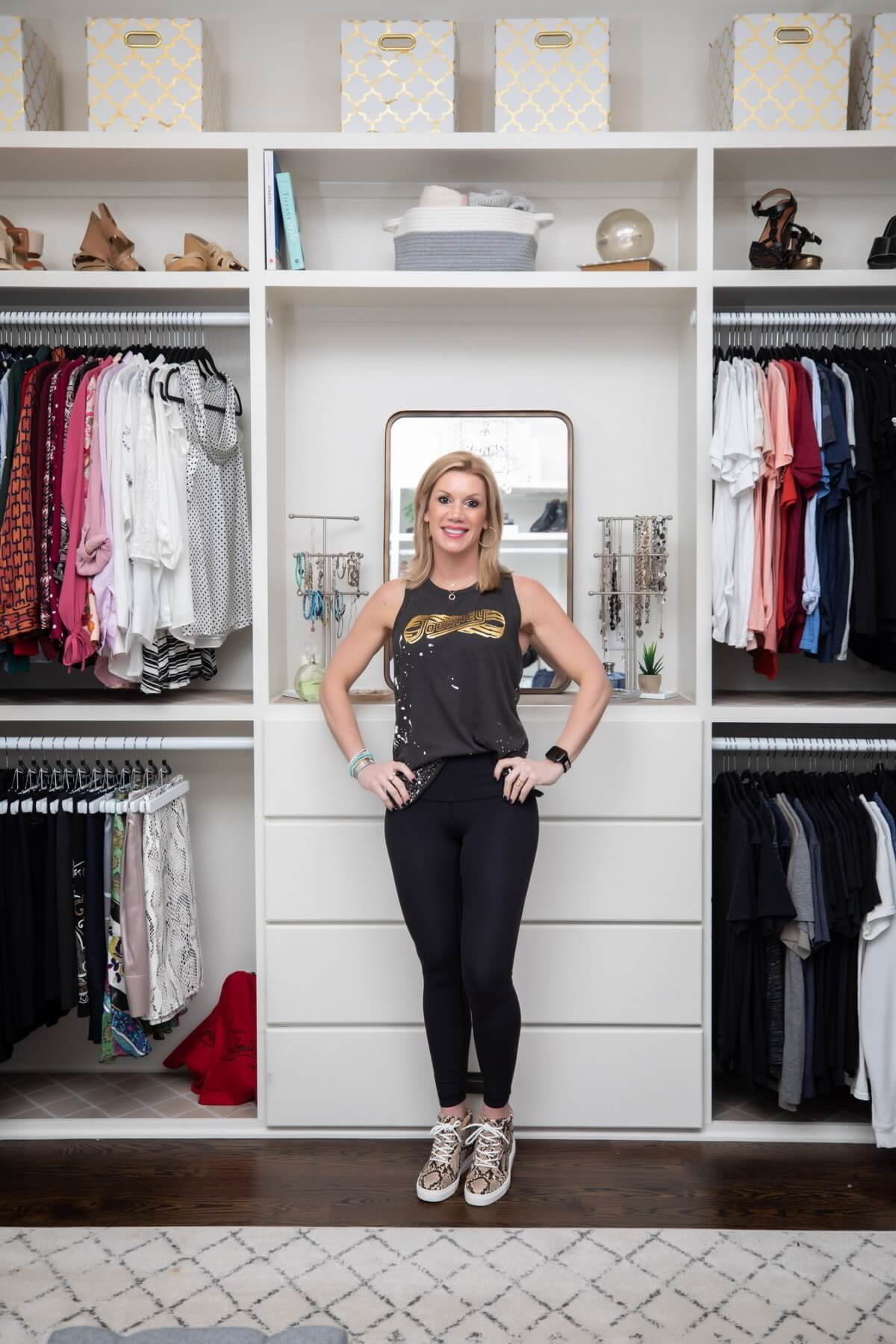 WIPT Designs owner, Beth Hayden, in a closet where she has maximized organization.