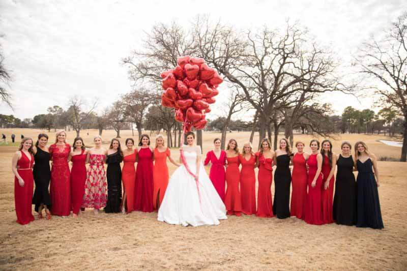 Heart balloons and wedding party outside