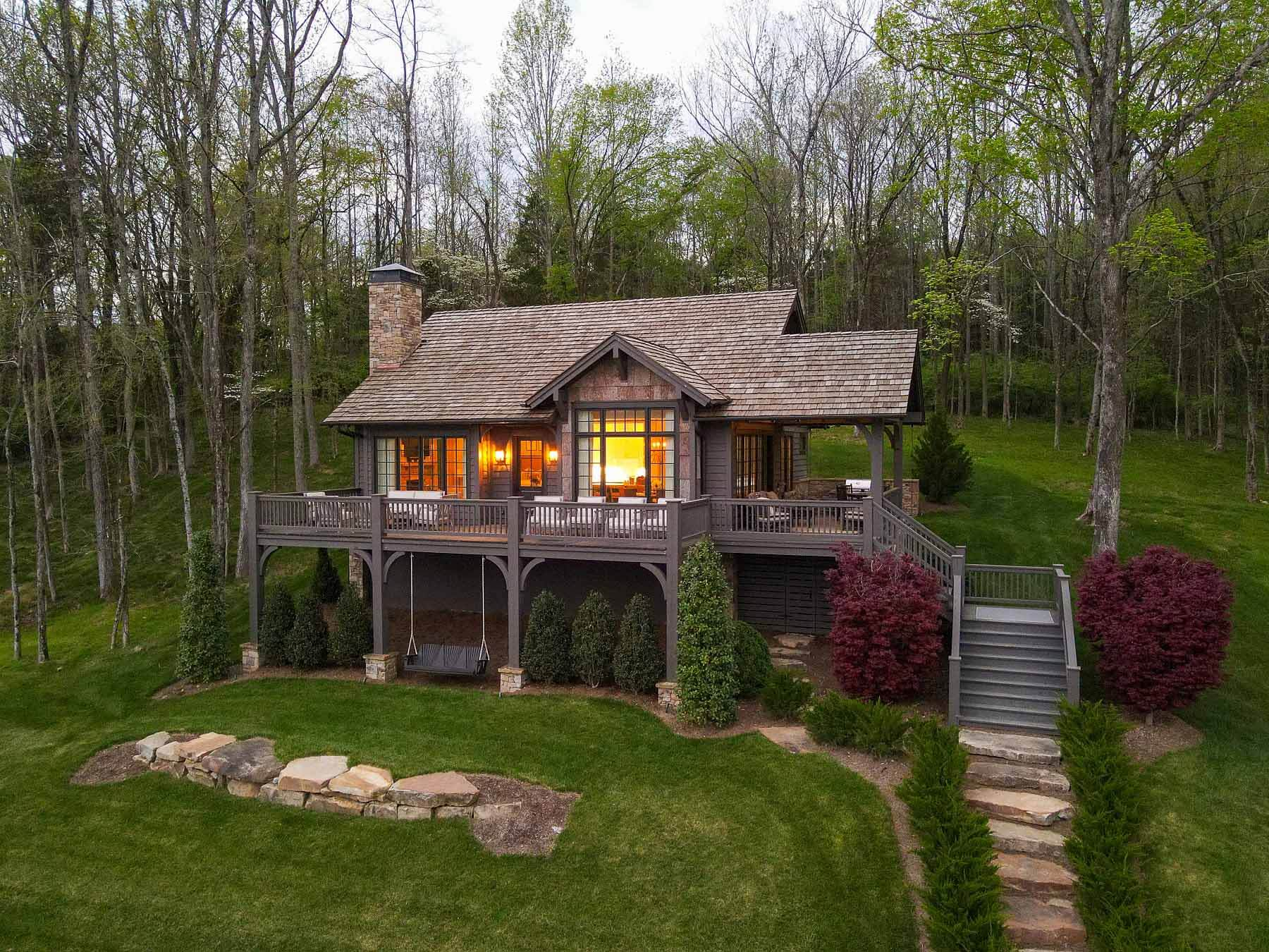 A second home in the woods by Castle Homes