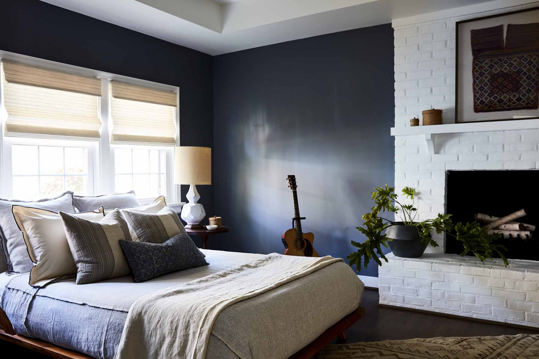 Master bedroom with fireplace and navy wall
