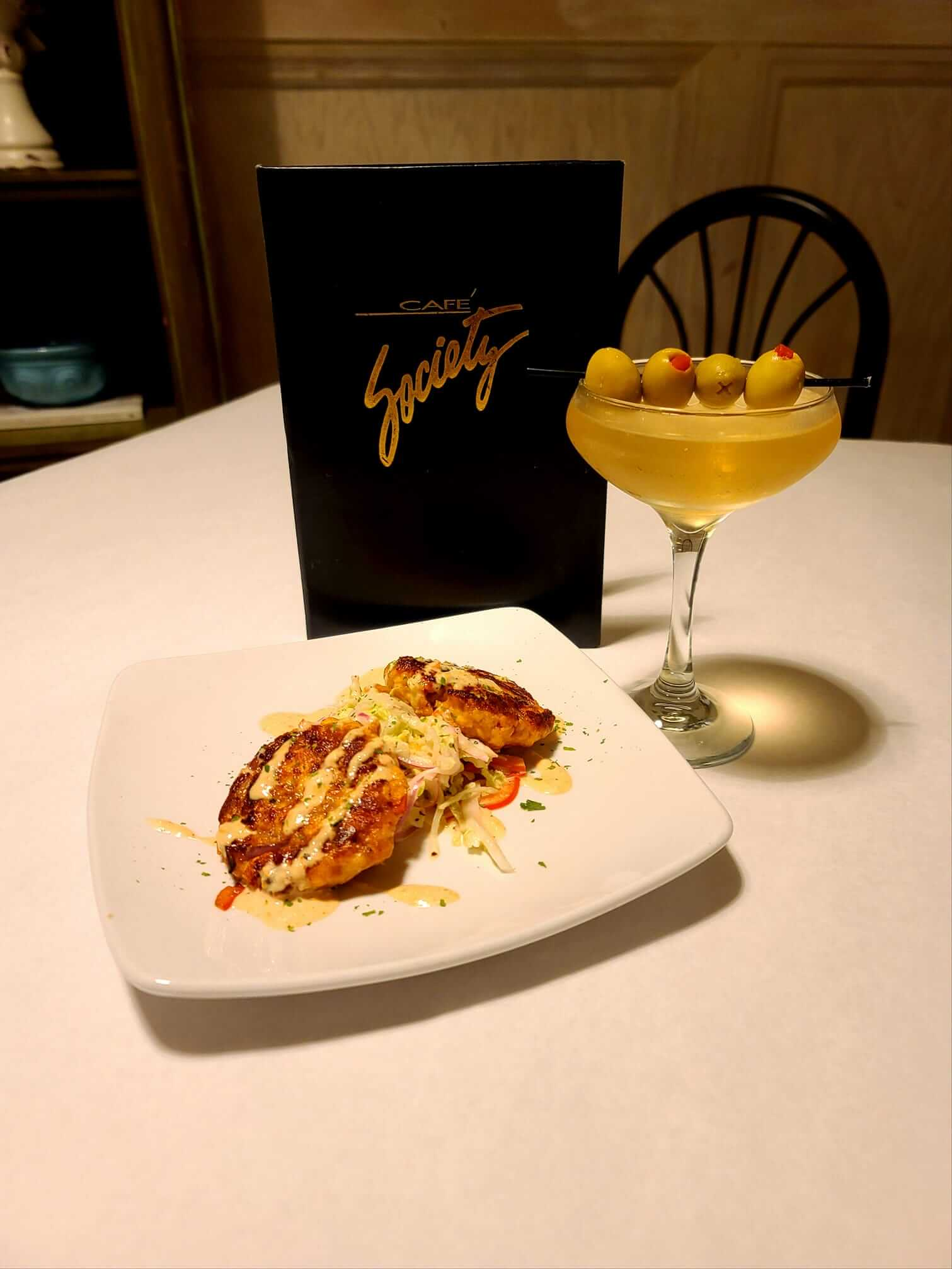 Salmon cakes and martini from Café Society Restaurant