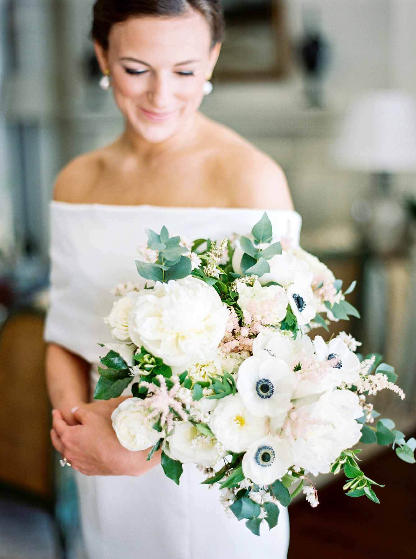 Alli Simmons in her wedding gown, holding her bouquet