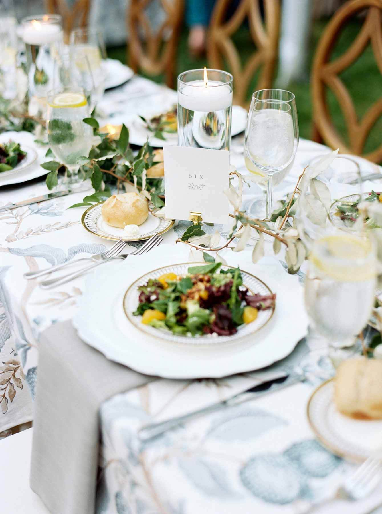 Tablescape at an interior designer's wedding, with a plate of salad