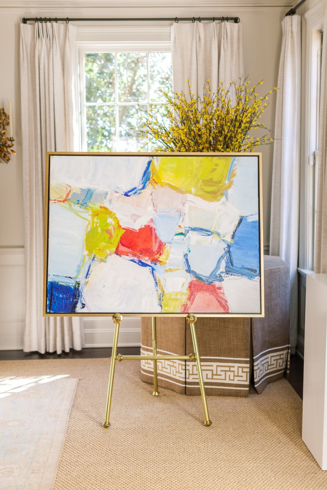 Abstract artwork on gold easel