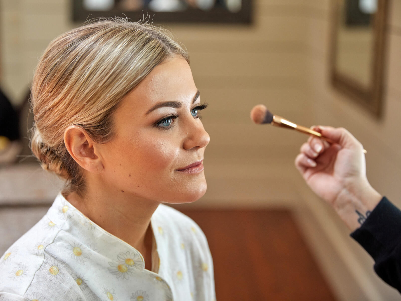 Kirby having her makeup done on her wedding day